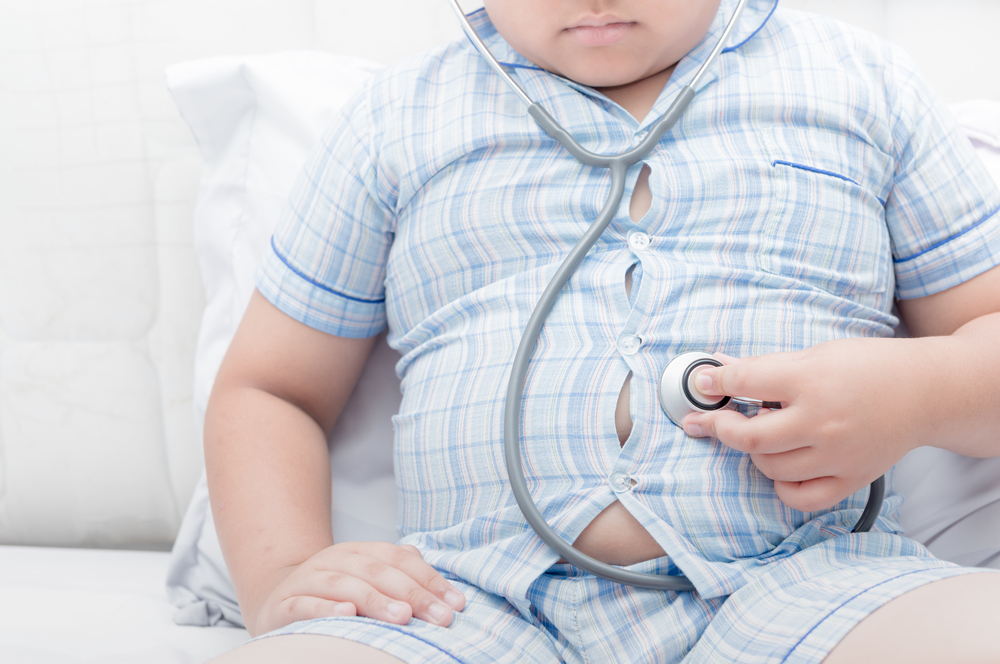 Obese,Fat,Boy,Check,Stomach,By,Stethoscope.,Tight,Shirt,Of