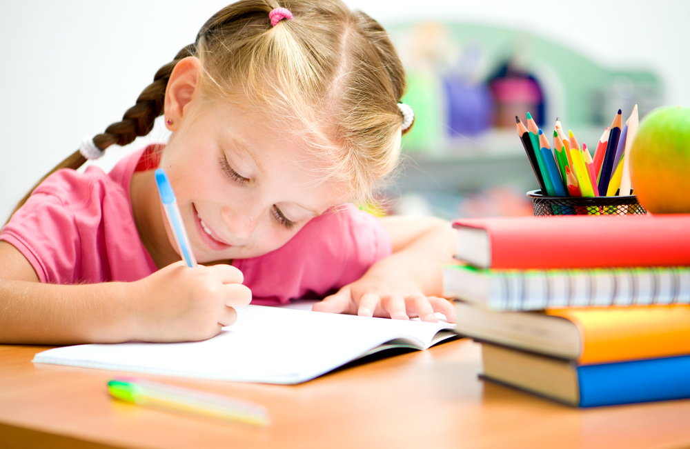 Little,Girl,At,The,Desk,Is,Writing