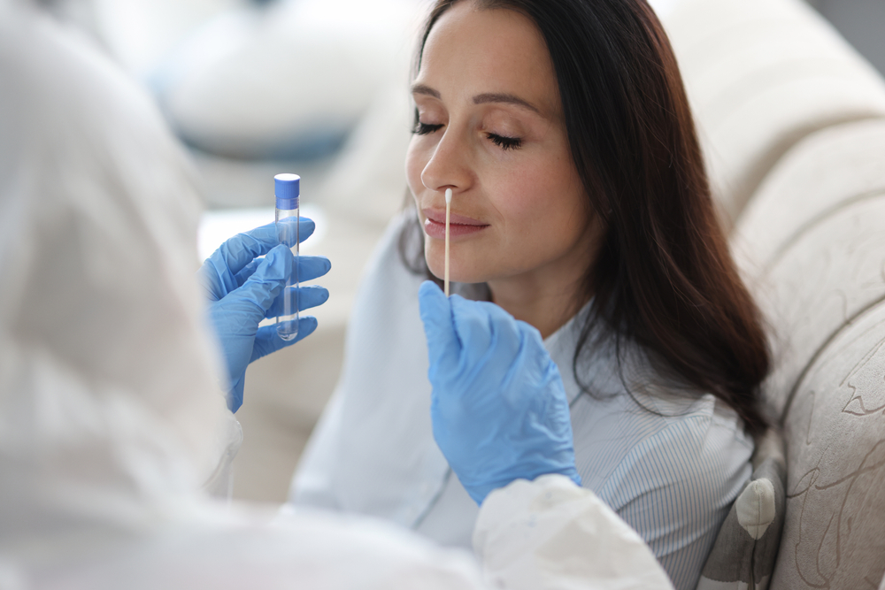 Doctor,Laboratory,Assistant,In,Protective,Suit,Takes,Swab,From,Nose