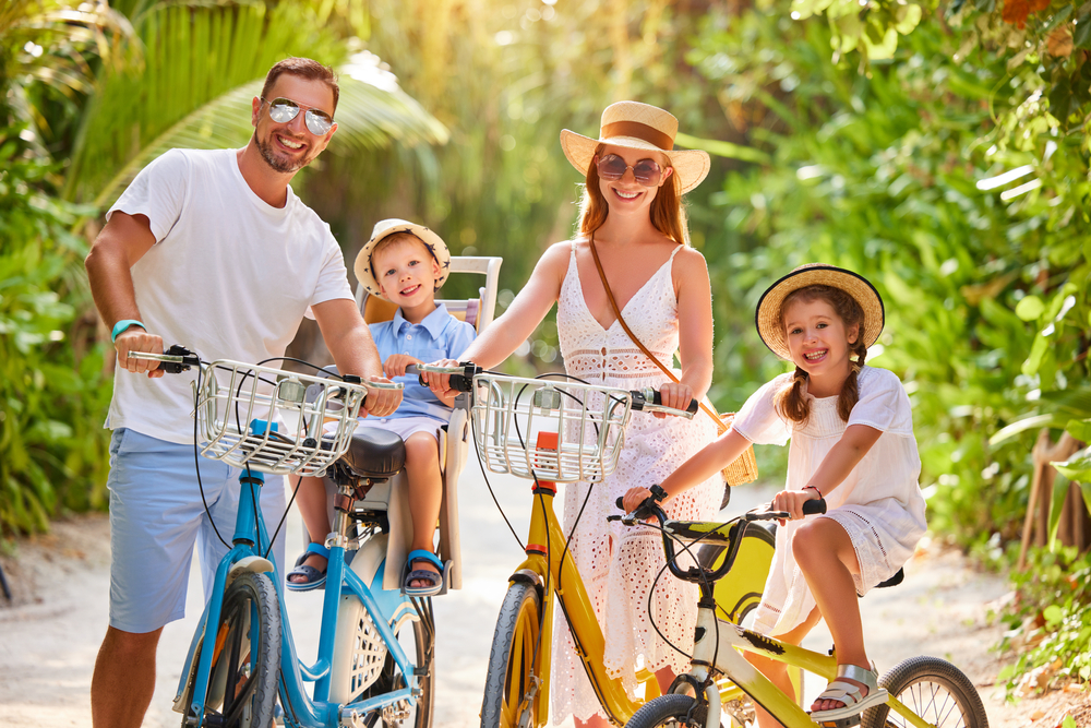 Happy,Family:,Parents,And,Kids,In,Summer,Outfits,Enjoying,Bicycle