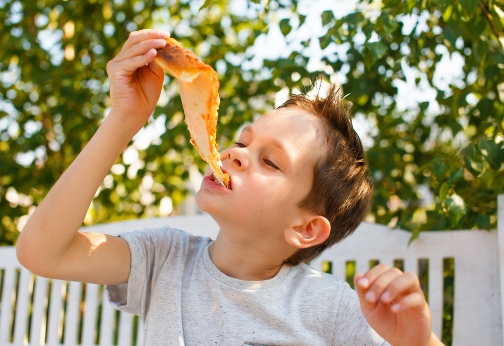 Boy,Eating,Pizza.,Child,Closed,His,Eyes,In,Pleasure,And