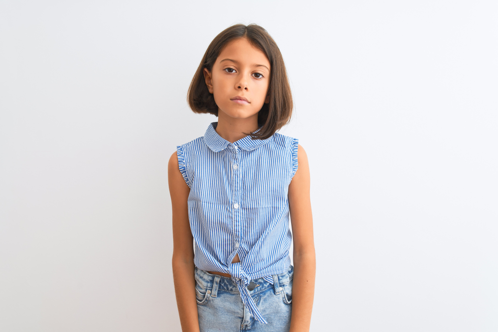 Young,Beautiful,Child,Girl,Wearing,Blue,Casual,Shirt,Standing,Over