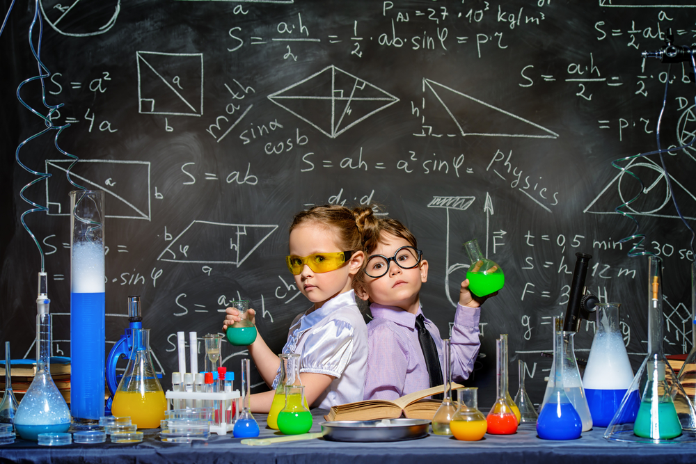 Two,Little,Children,Scientists,Making,Experiments,In,The,Laboratory.,Educational