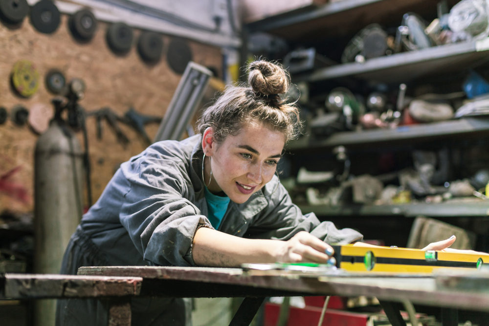 Young,Woman,Working,In,A,Workshop