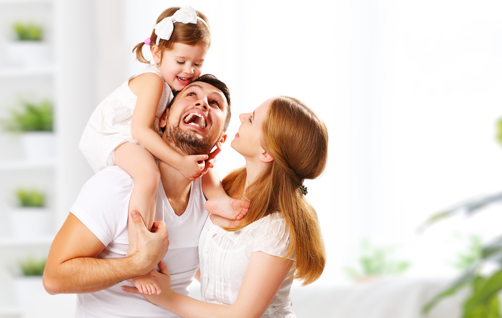 Happy,Family,Mother,,Father,,Child,Daughter,At,Home