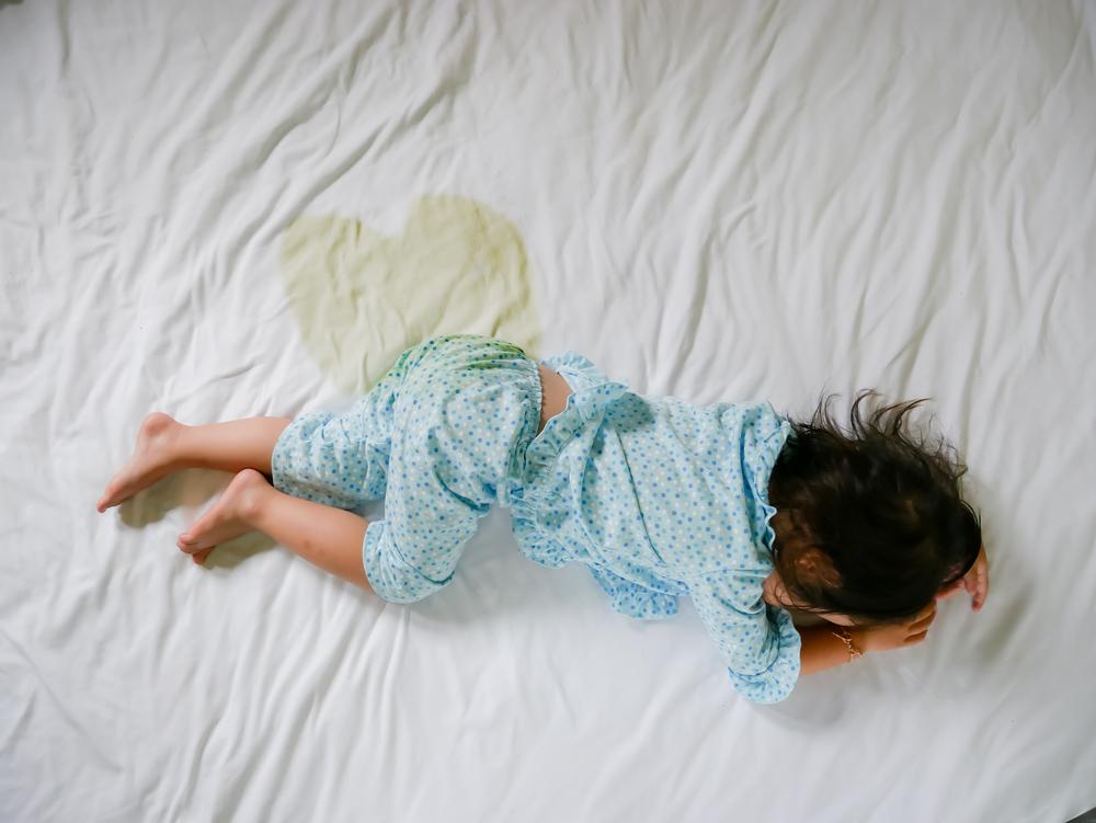 Bedwetting,,child,Pee,On,A,Mattress,little,Girl,Feet,And,Pee