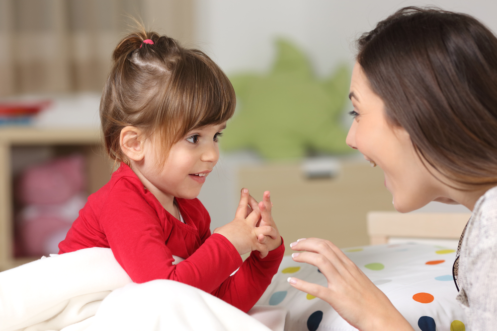 Mother,And,Toddler,Wearing,Red,Shirt,Playing,Together,On,A