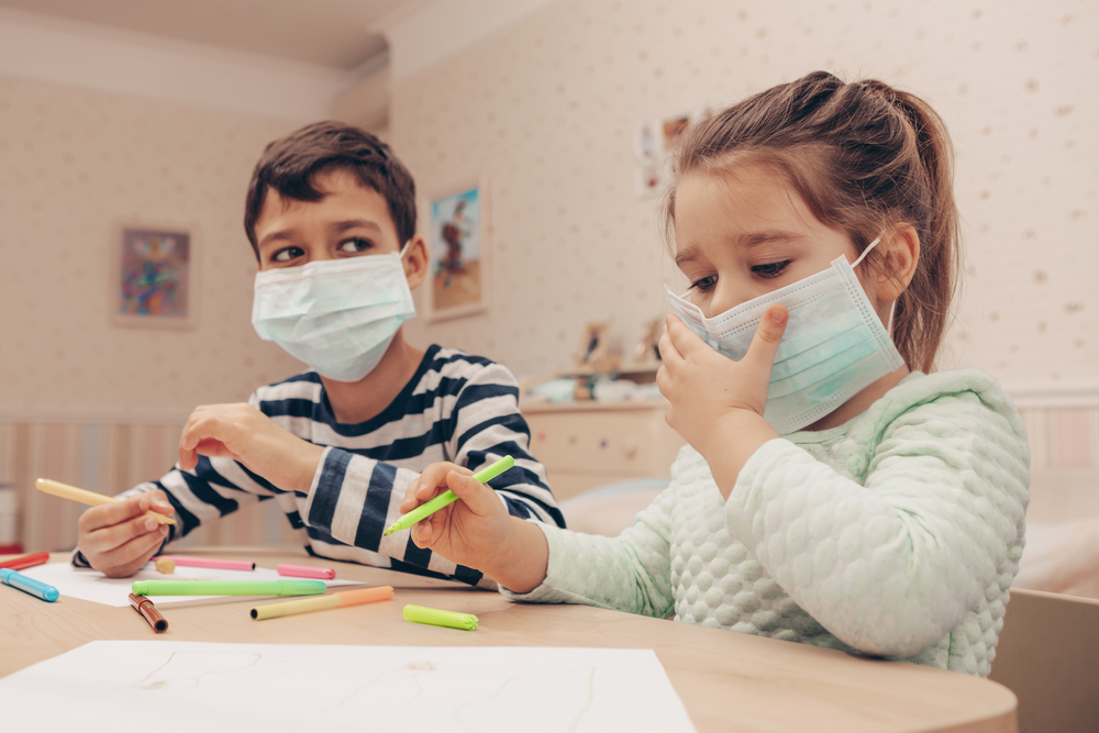 Cute,Children,Boy,And,Girl,In,Medical,Mask,Is,Sitting