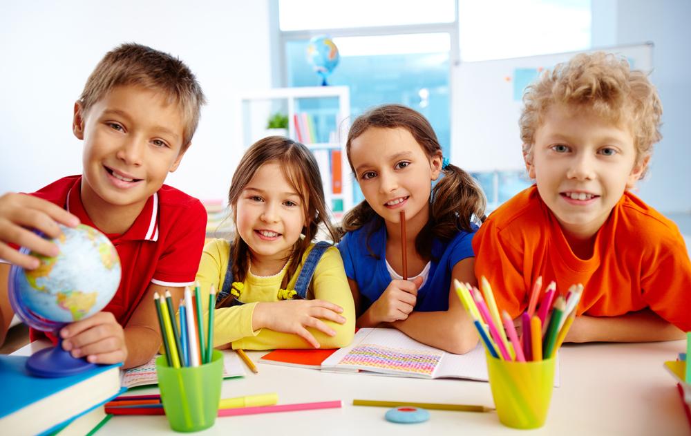Group,Of,Diligent,Schoolchildren,Looking,At,Camera,In,School