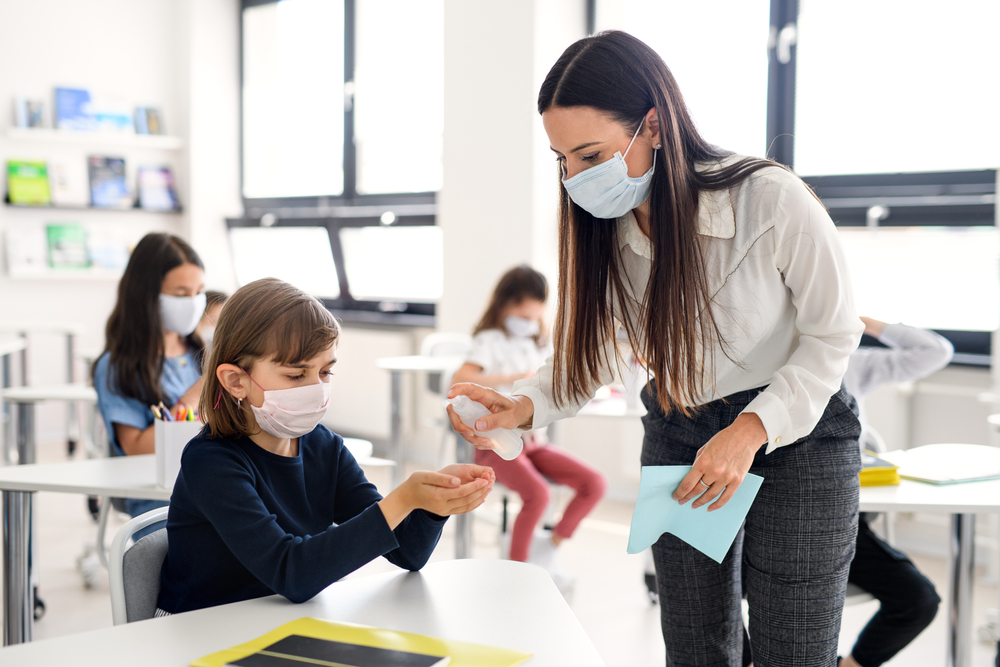 Teacher,,Children,With,Face,Mask,At,School,After,Covid-19,Quarantine