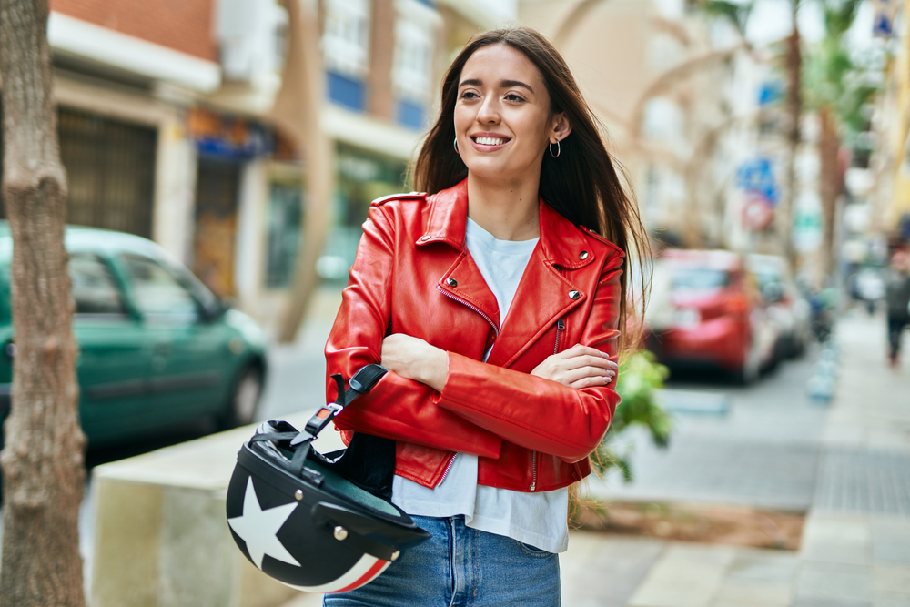 Young,Hispanic,Woman,Smiling,Happy,Holding,Moto,Helmet,At,The