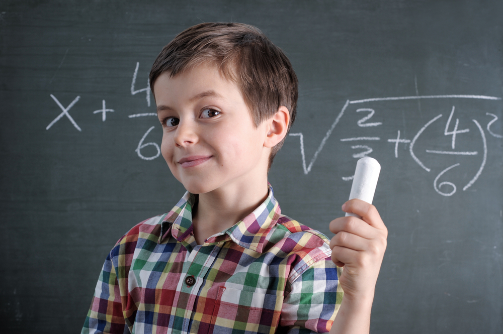 Young,Caucasian,Male,Child,Is,A,Maths,Genius,With,Chalk