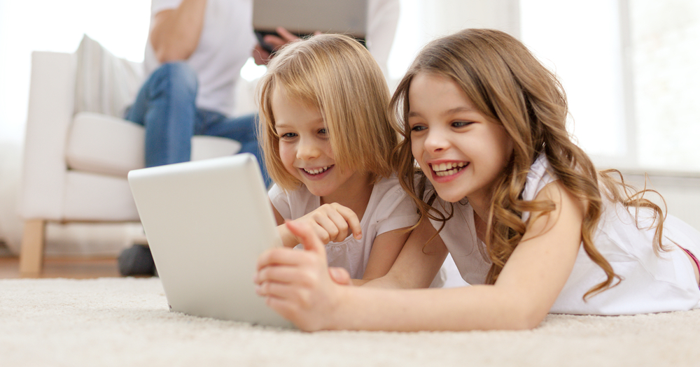 Family,,Children,,Technology,And,Home,Concept,-,Smiling,Sister,With