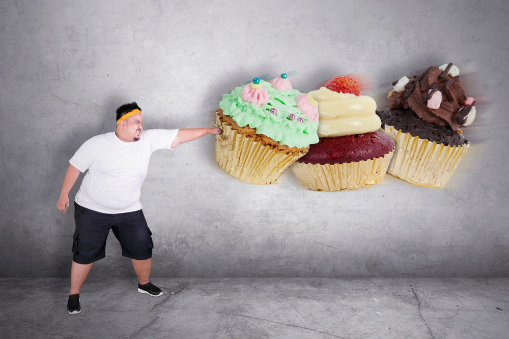 Picture,Of,An,Obese,Man,Refusing,To,Eat,Sweet,Food