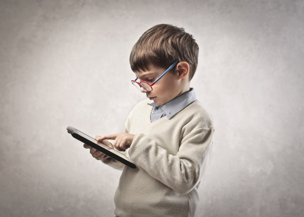 Child,Using,A,Tablet,Pc